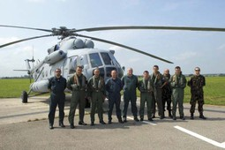 AIR FORCE PILOTS AND MECHANICS on the landing pad with the Mi-171Sh